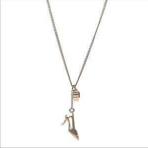 CHANEL Jewelry - Crystal CC Chanel heel motif necklace